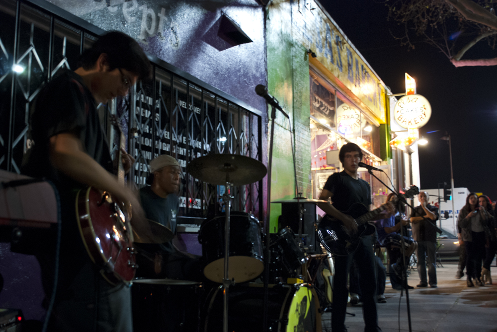 Band in front of panaderia. CHECK